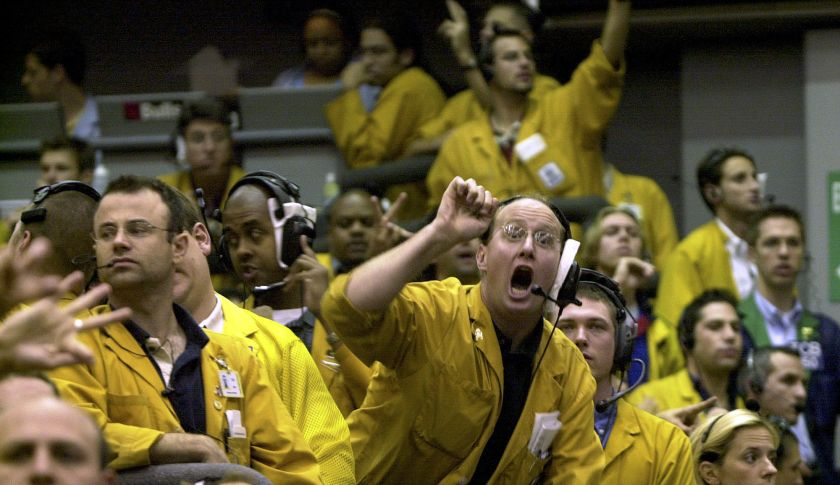 "Clerks in the Euro Dollar Futures pit at the Chicago Mercantile Exchange trade after the news that interest rates will remain the same Tuesday Sep. 16, 2003. The Fed said that the low rates, currently at a 45-year low, ""can be maintained for a considerable period."" (AP Photo/Anne Ryan)"