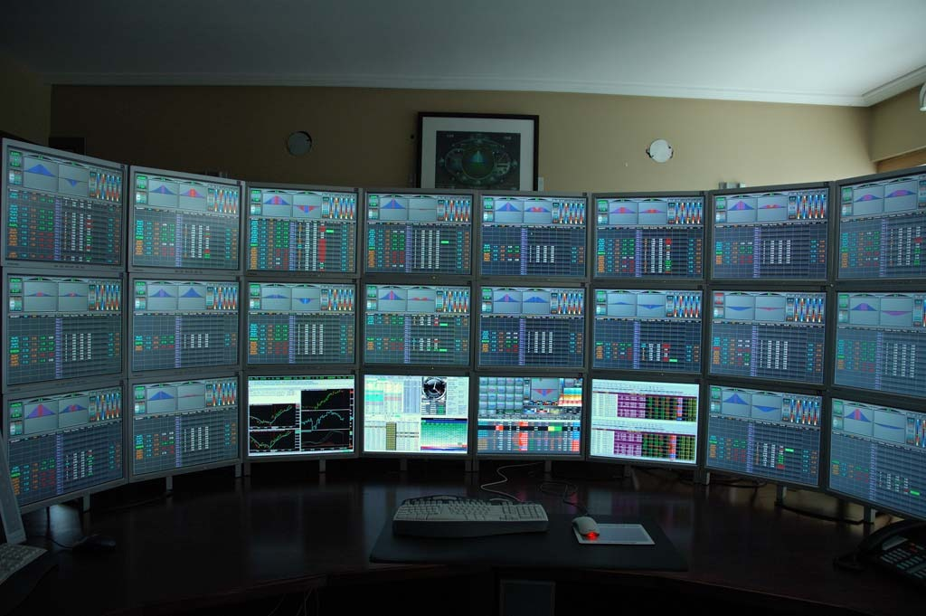 trading-desk-multiple-monitors