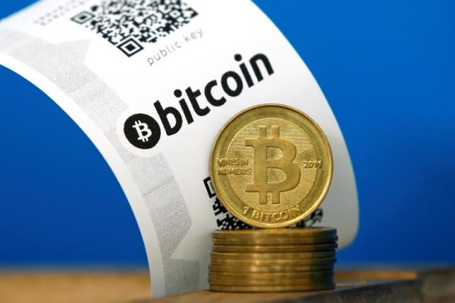 A Bitcoin (virtual currency) paper wallet with QR codes and coins are seen in an illustration picture taken at La Maison du Bitcoin in Paris July 11, 2014. REUTERS/Benoit Tessier